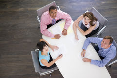 Four businesspeople at boardroom table Stock Photography