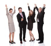 Four businesspeople celebrating Stock Images