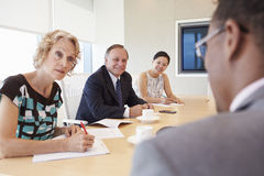 Four Businesspeople Having Meeting In Boardroom Royalty Free Stock Photo