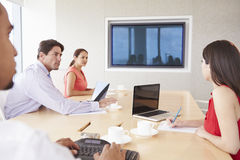 Four Businesspeople Having Video Conference In Boardroom Stock Photos
