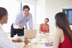Four Businesspeople Having Video Conference In Boardroom Stock Photography