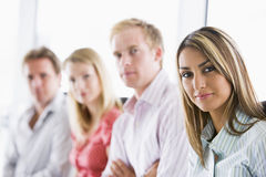 Four businesspeople sitting indoors Royalty Free Stock Photo