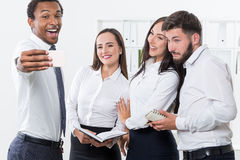Four businesspeople taking a selfie Royalty Free Stock Photography