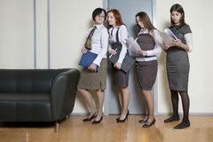 Four businesswoman standing in line Royalty Free Stock Photos