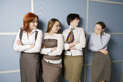 Four businesswoman standing in line Stock Images