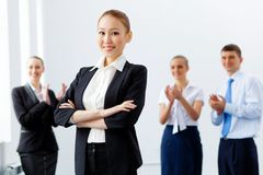 Four businesswomen standing in row Stock Image