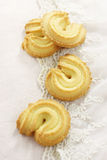 Four butter cookie. The four cookies on the white lace background Royalty Free Stock Image