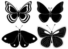 Four butterfly silhouettes Stock Photography