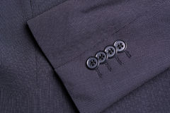 Four buttons on a black business jacket sleeve Stock Photo