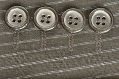 Four buttons on the fabric. Stock Images