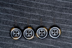 Four buttons on a pin-striped suit Stock Photos