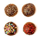 Four cakes. Delicious cupcakes on the white background royalty free stock photo