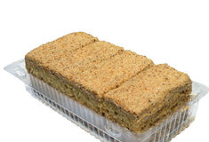 Four cakes in the plastic container Royalty Free Stock Image