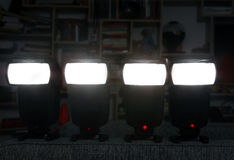 Four camera flashes Stock Photos