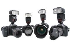 Four Cameras with flashes on white background Royalty Free Stock Image