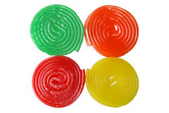 Four candies. Four spiral candies: green, orange, red and yellow Royalty Free Stock Images