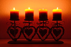 Four candles. Against white wall Royalty Free Stock Image