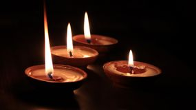 Four candles or butter lamps stock images