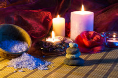 Four candles camellia stones and salt. For massage - orizzontal stock photo
