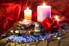 Four candles camellias little stones and salt. For massage stock photo