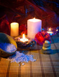 Four candles camellias stones and salt. For massage royalty free stock photos