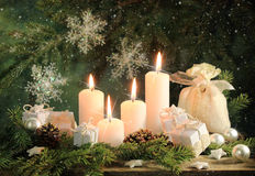 Four candles. Christmas gifts and candles composition stock images