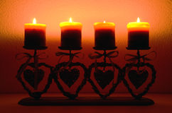 Four candles. In the darkness Royalty Free Stock Image