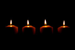 Four candles stock photography