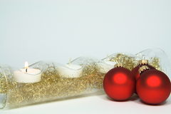 Four candles three red christmas tree balls Royalty Free Stock Images