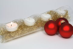 Four candles three red christmas tree balls Stock Images