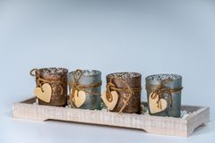 4 candlesticks decorated with a heart. Four candlesticks decorated with a heart stock photo