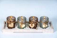 4 candlesticks decorated with a heart royalty free stock image