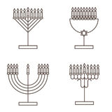 Four candlesticks with nine candles. Candlestick with candles for Hanukkah. Royalty Free Stock Photo