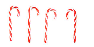 Four Candy canes. Four striped candy canes isolated on the white background Vector Illustration