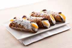 Four cannoli Sicilia or Sicilian cannoli. Four cannoli Sicilia, or Sicilian cannoli, deep fried pastry tubes with a sweet ricotta filling garnished with colorful stock photo