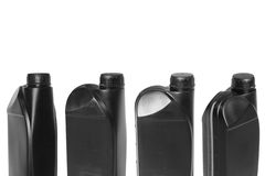 Four cans. Four black canister from the engine oil. Isolated Stock Images