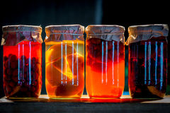 Four cans of compote fruit and berries Stock Photography