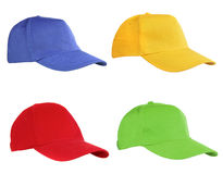 Four Caps Isolated On White Royalty Free Stock Photography