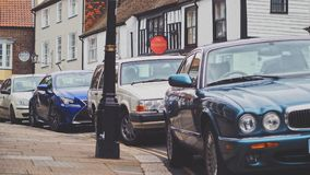 Four Car Parked Beside the Road Stock Photography