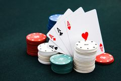 Four card  aces of different stripes and casino chips. Four cards aces of different stripes and casino chips royalty free stock photo