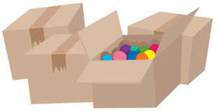 Four cardboard boxes and one with balls Stock Image