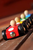 Four cars. Four wooden racing cars in starting position Stock Photos