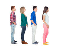 Four casual group of people in a row. Isolated over a white background stock photography