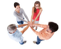 Four casual middle-aged friends holding hands royalty free stock photography