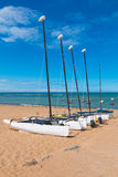 Four catamarans laid on the sand by the sea Royalty Free Stock Photography