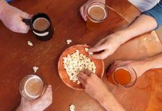 Men Enjoying Beer at Happy Hour. Four Caucasian men enjoying local beer during happy hour at a local brewery stock photos
