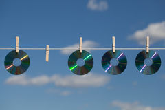 Four CDs On A Clotheslines Stock Photo