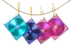 Four CDs in coloful cases fixe. Four CDs in colorful cases fixed with pins on the line Royalty Free Stock Photos