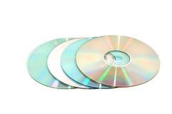 Four CDs in a row isolated Stock Photos