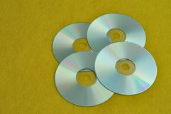 Four cds. On a yellow background stock photography